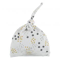 Bonnet léger pour bébés en coton organique de couleur blanc avec un imprimé à pois de la marque Bean's Barcelona