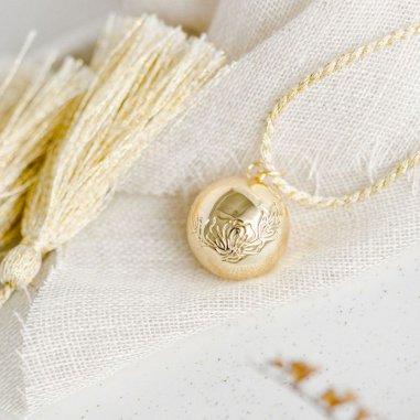 Bola de grossesse céleste de couleur or de la marque Pleine Lune